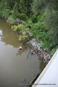 Trash Litters the Shoreline at the MD150 Bridge